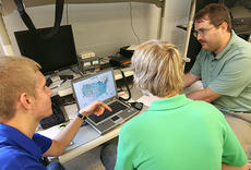"""<div class=""""source"""">Tom Dekle/Nelson County Schools</div><div class=""""image-desc"""">Nelson County Area Technology Center students Zach Plowed (left), Trevor Burba (middle), and instructor Charlie Cantrill discuss locations of other ham radio stations they have communicated with across north America using a satellite to relay transmissions. The two students are members of the technology club at NCATC.</div><div class=""""buy-pic""""></div>"""