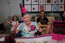"<div class=""source"">KACIE GOODE/The Kentucky Standard</div><div class=""image-desc"">Louise Hagan posed and waved at the camera Wednesday while celebrating her 103rd birthday with family and friends at Windsor Gardens. </div><div class=""buy-pic""><a href=""/photo_select/87937"">Buy this photo</a></div>"