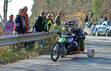 "<div class=""source"">KACIE GOODE/The Kentucky Standard</div><div class=""image-desc"">A racer flies around a curve on Cissal Hill Road Sunday afternoon while taking part in the annual Big Wheel Race.</div><div class=""buy-pic""><a href=""/photo_select/91230"">Buy this photo</a></div>"