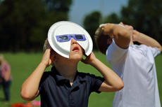 "<div class=""source"">KACIE GOODE/The Kentucky Standard</div><div class=""image-desc"">First graders at St. Gregory view the eclipse Monday with extra protection.</div><div class=""buy-pic""><a href=""/photo_select/88609"">Buy this photo</a></div>"
