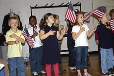 """<div class=""""source"""">Photo Submitted </div><div class=""""image-desc"""">Students from Helen Filiatreau's kindergarten class sang.  They include Bob Logsdon, Cameron Turner, Madison Livers, Olivia Feger, McKenna Ice, and T.J. Greenwell.</div><div class=""""buy-pic""""></div>"""