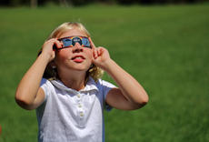 "<div class=""source"">KACIE GOODE/The Kentucky Standard</div><div class=""image-desc"">A student views the eclipse Monday at St. Gregory School.</div><div class=""buy-pic""><a href=""/photo_select/88614"">Buy this photo</a></div>"