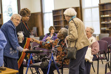 """<div class=""""source"""">KACIE GOODE/The Kentucky Standard</div><div class=""""image-desc"""">Guests mingle with Sister Pat Haley Saturday after a special presentation at which Haley sang spirituals.</div><div class=""""buy-pic""""><a href=""""/photo_select/83488"""">Buy this photo</a></div>"""