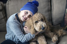 "<div class=""source"">KACIE GOODE/The Kentucky Standard</div><div class=""image-desc"">Alexa Hughes, 9, cuddles her puppy Stella. The dog has been a source of happiness for the third-grader, who has spent the last five months battling stage four ovarian cancer.</div><div class=""buy-pic""><a href=""/photo_select/83893"">Buy this photo</a></div>"