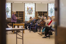 """<div class=""""source"""">KACIE GOODE/The Kentucky Standard</div><div class=""""image-desc"""">Theresa Knabel, SCN, gives a talk on Slave Families of Nazareth Saturday in the Columba Room.</div><div class=""""buy-pic""""><a href=""""/photo_select/83492"""">Buy this photo</a></div>"""