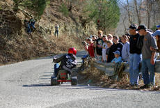 "<div class=""source"">KACIE GOODE/The Kentucky Standard</div><div class=""image-desc"">Spectators watch and film as racers come around the curve Sunday during the annual Cissal Hill Big Wheel Race in New Haven.</div><div class=""buy-pic""><a href=""/photo_select/91234"">Buy this photo</a></div>"