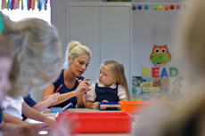 "<div class=""source"">KACIE GOODE/The Kentucky Standard</div><div class=""image-desc"">Harper Frye, K-4, recieves a little help readying her supplies Wednesday morning on the first day of school at Bluegrass Christian Academy.</div><div class=""buy-pic""><a href=""/photo_select/88143"">Buy this photo</a></div>"