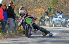 "<div class=""source"">KACIE GOODE/The Kentucky Standard</div><div class=""image-desc"">A racer's shoe smokes as he tries to gain control around a sharp curve Sunday during the Cissal Hill Big Wheel Race in New Haven.</div><div class=""buy-pic""><a href=""/photo_select/91221"">Buy this photo</a></div>"