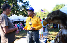 """<div class=""""source"""">KACIE GOODE/The Kentucky Standard</div><div class=""""image-desc"""">Volunteer Naturalist Dick Dennis stops and talks with guests about birds of prey Saturday during Bernheim's ColorFest celebration. Dennis has been involved in educational activities at the forest for more than 11 years, having fallen in love with the location as a kid.</div><div class=""""buy-pic""""><a href=""""/photo_select/80413"""">Buy this photo</a></div>"""