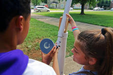"<div class=""source"">KACIE GOODE/The Kentucky Standard</div><div class=""image-desc"">JaKobe Posey and Macie Rawlins watch clouds move inront of the sun Friday at Bardstown High School using a homemade piece of equipment. The students were practicing for the eclipse Modnay afternoon.</div><div class=""buy-pic""><a href=""/photo_select/88611"">Buy this photo</a></div>"