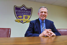 """<div class=""""source"""">KACIE GOODE/The Kentucky Standard</div><div class=""""image-desc"""">Brent Holsclaw sits in the conference room at Bardstown City Schools Board of Education's Central Office on North Fifth Street. He has served the district for 13 years but announced this week his plans to retire at the end of the school year.</div><div class=""""buy-pic""""><a href=""""/photo_select/92202"""">Buy this photo</a></div>"""