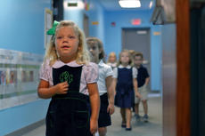 "<div class=""source"">KACIE GOODE/The Kentucky Standard</div><div class=""image-desc"">Cora Rogers, K-4, walks in line with her new classmates Wednesday morning as the young students head upstairs to join the rest of Bluegrass Christian Academy on the first day of school.</div><div class=""buy-pic""><a href=""/photo_select/88145"">Buy this photo</a></div>"