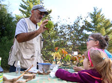 """<div class=""""source"""">KACIE GOODE/The Kentucky Standard</div><div class=""""image-desc"""">Volunteer Naturalist Joe Rogers teaches kids about some of the plant life thy might encounter during a discovery station at Bernheim's ColorFest.</div><div class=""""buy-pic""""><a href=""""/photo_select/80415"""">Buy this photo</a></div>"""