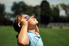 "<div class=""source"">KACIE GOODE/The Kentucky Standard</div><div class=""image-desc"">A child views the eclipse with special glasses Monday at St. Gregory School.</div><div class=""buy-pic""><a href=""/photo_select/88604"">Buy this photo</a></div>"