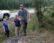 "<div class=""source"">KACIE GOODE/The Kentucky Standard</div><div class=""image-desc"">Andrew Ballard, a cousin of Crystal Rogers, climbs a rockway off the Bluegrass Parkway into a wooded area. Ballard and other friends and family spend most of Sunday and Monday searching the area where Crystal's vehicle had been found abandoned with personal belongings and keys inside. Crystal has been missing since Friday.</div><div class=""buy-pic""><a href=""/photo_select/67394"">Buy this photo</a></div>"