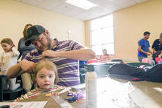 """<div class=""""source"""">KACIE GOODE/The Kentucky Standard</div><div class=""""image-desc"""">Dad Tyler Teske works on a hair style for 2-year-old daughter Kaycee during a Daddy/Daughter Hair Class at the Nelson County Public Library Wednesday.</div><div class=""""buy-pic""""><a href=""""/photo_select/84182"""">Buy this photo</a></div>"""