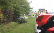 "<div class=""source"">RANDY PATRICK/The Kentucky Standard</div><div class=""image-desc"">The driver of the pickup on the left was injured and transported by ambulance to Flaget Memorial Hospital Wednesday afternoon after he collided with the pickup on the right after he tried to pass vehicles on Louisville Road and lost control. Alex Chism, driver of the second truck, was not seriously injured and refused treatment. Sheriff's deputies said they had been looking for the other driver because he had been reported driving fast. They would not release his name.</div><div class=""buy-pic""></div>"