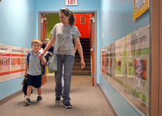 """<div class=""""source"""">KACIE GOODE/The Kentucky Standard</div><div class=""""image-desc"""">Benaiah Williams, K-4, holds Mom's hand while walking to class Wednesday morning on the first day of school for Bluegrass Christian Academy.</div><div class=""""buy-pic""""><a href=""""/photo_select/88147"""">Buy this photo</a></div>"""