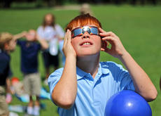 "<div class=""source"">KACIE GOODE/The Kentucky Standard</div><div class=""image-desc"">Deegan Brown takes a break from playing to check the progress of Monday's solar eclipse. St. Gregory students came outside periodically to watch the changes.</div><div class=""buy-pic""><a href=""/photo_select/88606"">Buy this photo</a></div>"