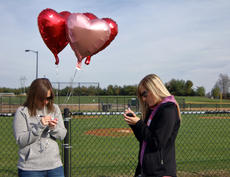 """<div class=""""source"""">KACIE GOODE/The Kentucky Standard</div><div class=""""image-desc"""">Messages are written on balloons Saturday prior to a balloon release to remember two young women killed in an August crash.</div><div class=""""buy-pic""""><a href=""""/photo_select/90903"""">Buy this photo</a></div>"""
