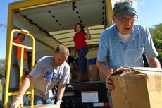 "<div class=""source"">KACIE GOODE/The Kentucky Standard</div><div class=""image-desc"">David Cahoe and Jeremey Booher grab boxes to hand to waiting students at Cox's Creek Friday. Third-graders helped organize a drive to help victims of Hurricane Harvey.</div><div class=""buy-pic""><a href=""/photo_select/89658"">Buy this photo</a></div>"
