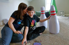 """<div class=""""source"""">KACIE GOODE/The Kentucky Standard</div><div class=""""image-desc"""">Kaleb and his mom, Lee, hang out in his """"playroom"""" at their Botland home.</div><div class=""""buy-pic""""><a href=""""/photo_select/94267"""">Buy this photo</a></div>"""