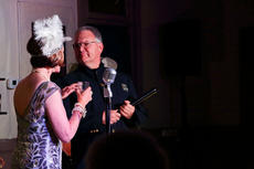 "<div class=""source"">KACIE GOODE/The Kentucky Standard</div><div class=""image-desc"">Officer Joey suspects illegal activity during ""Speakeasy Bourbon Style"" an original play by Toni Wiley.</div><div class=""buy-pic""><a href=""/photo_select/89218"">Buy this photo</a></div>"