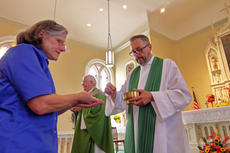 "<div class=""source"">KACIE GOODE/The Kentucky Standard</div><div class=""image-desc"">The Rev. John R. Johnson, pastor of St. Michael, assist Archbishop Joseph E. Kurtz in communion Sunday during the church's 225th anniversary celebration.</div><div class=""buy-pic""><a href=""/photo_select/89744"">Buy this photo</a></div>"
