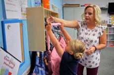 "<div class=""source"">KACIE GOODE/The Kentucky Standard</div><div class=""image-desc"">Children put away their backpacks as they enter class Wednesday morning on the first day of school for Bluegrass Christian Academy.</div><div class=""buy-pic""><a href=""/photo_select/88148"">Buy this photo</a></div>"