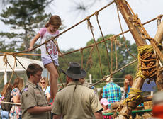 """<div class=""""source"""">KACIE GOODE/The Kentucky Standard</div><div class=""""image-desc"""">Kids take on a rope bridge challenge with the help of boy scouts during Bernheim's ColorFest.</div><div class=""""buy-pic""""><a href=""""/photo_select/80417"""">Buy this photo</a></div>"""