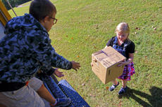 "<div class=""source"">KACIE GOODE/The Kentucky Standard</div><div class=""image-desc"">Students assist in loading boxes of supplies to be sent to different schools in Texas. Cox'sCreek Elementary students helped organize the drive, a collaboration with other schools in the area, for a project-based learning assignment.</div><div class=""buy-pic""><a href=""/photo_select/89660"">Buy this photo</a></div>"