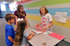 "<div class=""source"">KACIE GOODE/The Kentucky Standard</div><div class=""image-desc"">Students play a word game Friday at Bluegrass Christian Academy. Sixth graders hosted in-school carnival activities to raise money for South Sudan.</div><div class=""buy-pic""><a href=""/photo_select/89661"">Buy this photo</a></div>"