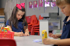 "<div class=""source"">KACIE GOODE/The Kentucky Standard</div><div class=""image-desc"">Violet Foster colors a headband Wednesday morning while, in the foreground, Luke Hedgespeth chooses his colors as class gets settled on the first day of school at Bluegrass Christian Academy.</div><div class=""buy-pic""><a href=""/photo_select/88151"">Buy this photo</a></div>"