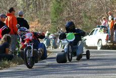 "<div class=""source"">KACIE GOODE/The Kentucky Standard</div><div class=""image-desc"">Racers come around the curve Sunday during the 2017 Cissal Hill Big Wheel Race.</div><div class=""buy-pic""><a href=""/photo_select/91225"">Buy this photo</a></div>"
