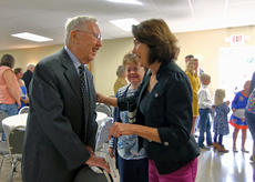 "<div class=""source"">KACIE GOODE/The Kentucky Standard</div><div class=""image-desc"">Dr. Edward Hord, left, greets former patients and fellow church goers Sunday during St. Michael Catholic Church's 225th anniversary celebration. Soon to be 94, Hord is currently the oldest living parishoner of the church, and has been attending since 1956, after opening a dental practice in Bloomfield.</div><div class=""buy-pic""><a href=""/photo_select/89746"">Buy this photo</a></div>"