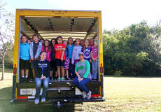 "<div class=""source"">KACIE GOODE/The Kentucky Standard</div><div class=""image-desc"">Students pile inside a truck that will make its way down to Texas this weekend to deliver supplies to five school affected by Hurricane Harvey. The items were collected with the help of Cox's Creek students, who organized the drive, and several other schools in the area who donated. Nelson County Schools donated the truck for the trip, and two of its educators will be making the drive.</div><div class=""buy-pic""><a href=""/photo_select/89664"">Buy this photo</a></div>"