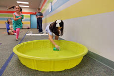 "<div class=""source"">KACIE GOODE/The Kentucky Standard</div><div class=""image-desc"">Students play a water race game Friday at Bluegrass Christian Academy. Sixth graders hosted in-school carnival activities to raise money for South Sudan.</div><div class=""buy-pic""><a href=""/photo_select/89665"">Buy this photo</a></div>"