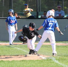 """<div class=""""source"""">Peter W. Zubaty</div><div class=""""image-desc"""">Nelson County A's Luke Bendock avoids the tag from a Valley Station player. Bendock and his teammates were 7-8 year old District 2 champs following a 10-7 win over South Oldham A on Sunday. </div><div class=""""buy-pic""""><a href=""""/photo_select/28096"""">Buy this photo</a></div>"""