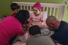 "<div class=""source"">KACIE GOODE/The Kentucky Standard</div><div class=""image-desc"">The Hughes family joins hands in prayer during the bedtime ritual for daughter Alexa, who has been battling stage four cancer for the past five months.</div><div class=""buy-pic""><a href=""/photo_select/83898"">Buy this photo</a></div>"