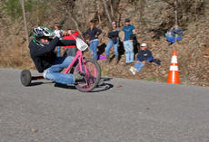 "<div class=""source"">KACIE GOODE/The Kentucky Standard</div><div class=""image-desc"">A racer flies around a curve on Cissal Hill Road Sunday afternoon while taking part in the annual Big Wheel Race.</div><div class=""buy-pic""><a href=""/photo_select/91228"">Buy this photo</a></div>"