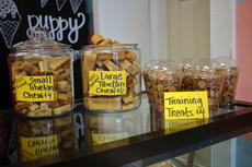 "<div class=""source"">KACIE GOODE/The Kentucky Standard</div><div class=""image-desc"">Treats are displayed on top the counter at Just Barked Friday afternoon during the dog bakery and boutique's grand opening on North Third.</div><div class=""buy-pic""><a href=""/photo_select/88750"">Buy this photo</a></div>"