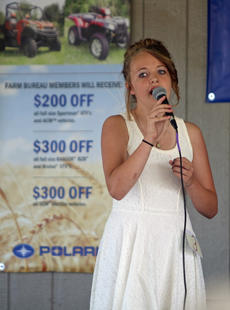 """<div class=""""source"""">KACIE GOODE/The Kentucky Standard</div><div class=""""image-desc"""">Alexis Raisor performs """"I Dreamed a Dream"""" during youth talent show Saturday, which correlated with Nelson County Agriculture Day. Raisor took first for the Nelson County Farm Bureau contestants in the talent competition. </div><div class=""""buy-pic""""><a href=""""/photo_select/77838"""">Buy this photo</a></div>"""