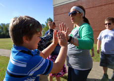 "<div class=""source"">KACIE GOODE/The Kentucky Standard</div><div class=""image-desc"">Teacher Nikki Booher high-fives some of the students who helped organize a drive for Hurrican Harvey victims.</div><div class=""buy-pic""><a href=""/photo_select/89669"">Buy this photo</a></div>"
