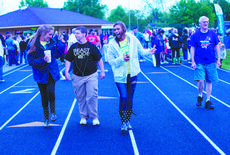 """<div class=""""source"""">RANDY PATRICK/The Kentucky Standard</div><div class=""""image-desc"""">Bailee Correro, left, Drew Hahn and Sydney Pohlman, students at Bardstown High School's National Honor Society, dance, rather than walk, around the track. At far right is Charles Mattingly.</div><div class=""""buy-pic""""><a href=""""/photo_select/47048"""">Buy this photo</a></div>"""