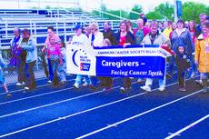 """<div class=""""source"""">RANDY PATRICK/The Kentucky Standard</div><div class=""""image-desc"""">Caregivers walk a lap around the track at Bardstown High School at the start of Relay for Life 2013.</div><div class=""""buy-pic""""><a href=""""/photo_select/47041"""">Buy this photo</a></div>"""