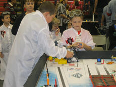 "<div class=""source""></div><div class=""image-desc"">Two St. Joseph School students work to fix their robot during a break in the competition. </div><div class=""buy-pic""></div>"