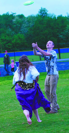 """<div class=""""source"""">RANDY PATRICK/The Kentucky Standard</div><div class=""""image-desc"""">Teenagers pass the time playing Frisbee at the Bardstown High School track during Relay for Life.</div><div class=""""buy-pic""""><a href=""""/photo_select/47043"""">Buy this photo</a></div>"""
