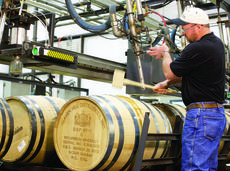 """<div class=""""source"""">FORREST BERKSHIRE/The Kentucky Standard</div><div class=""""image-desc"""">Eddie """"Fish"""" Livers, a filler operator for Heaven Hill Distilleries, fills the company's 6.5 millionth barrel of bourbon </div><div class=""""buy-pic""""><a href=""""/photo_select/45888"""">Buy this photo</a></div>"""