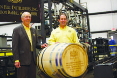 """<div class=""""source"""">FORREST BERKSHIRE/The Kentucky Standard</div><div class=""""image-desc"""">Parker Beam, right, and his son, Craig Beam, the sixth- and seventh-generation master distillers for Heaven Hill, stand beside the 6.5 millionth barrel of bourbon produced by the company Tuesday.</div><div class=""""buy-pic""""><a href=""""/photo_select/45889"""">Buy this photo</a></div>"""