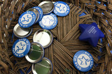 """<div class=""""source"""">Erin L. McCoy/The Kentucky Standard</div><div class=""""image-desc"""">Colon cancer awareness buttons were available at Bluegrass Community Family Practice.</div><div class=""""buy-pic""""><a href=""""/photo_select/24658"""">Buy this photo</a></div>"""